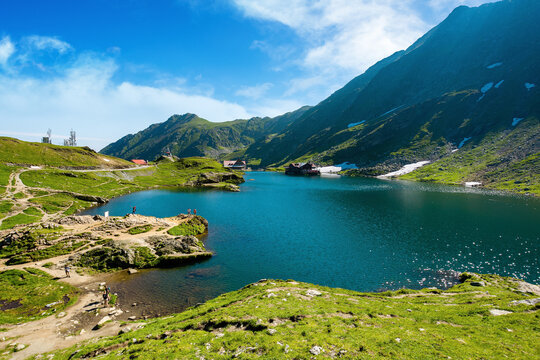 landscape of balea lake in fagaras mountains. wonderful summer nature scenery in the morning. popular travel destination of romania