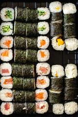Fototapeta fresh sushi roll seafood multicolored maki susi salmon, tuna, rice, nori, wasabi, sesame asian food  obraz
