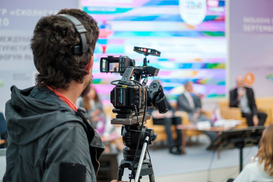 Cameraman shooting video and broadcasting conference