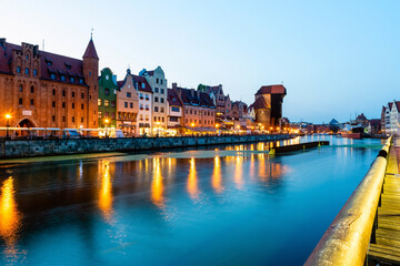 Gdansk night city riverside view. View on famous crane and facades of old medieval houses