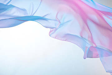 Smooth elegant colorful transparent cloth separated on white background. Texture of flying fabric.