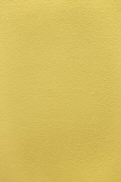 Gold textured background.  Simple goldish surface and light foil texture effect.  Plain backdrop, blank template, golden wallpaper with copy space for invitations, backdrops, websites, etc.