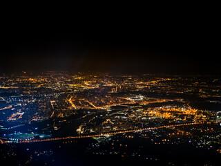 aerial view illuminated suburbs of city at night - fototapety na wymiar