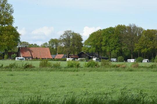 landscape with farmhouse and farmers campsite in the Dutch region of Twente