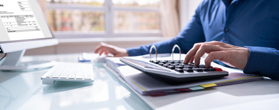 Financial Accounting. Man Using Calculator