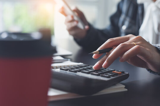 Business and finance concept, Business woman, accountant using calculator to calculate business data at office