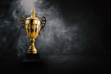 Wall Murals London 1st champion award, the best prize and winner concept, championship cup or winner trophy on wood table on dark wall and white smoke background