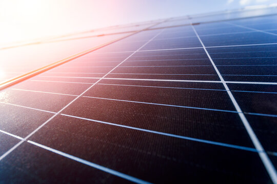 Photovoltaic solar panels on blue sky background
