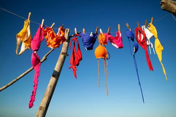 Obraz Female swimwear hanging in the sun to dry - fototapety do salonu
