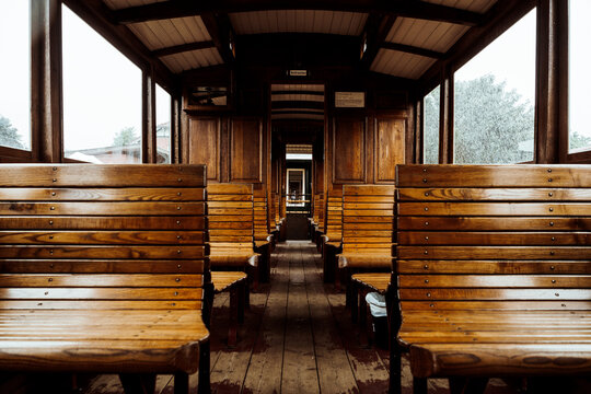 benches in old wooden train wagon