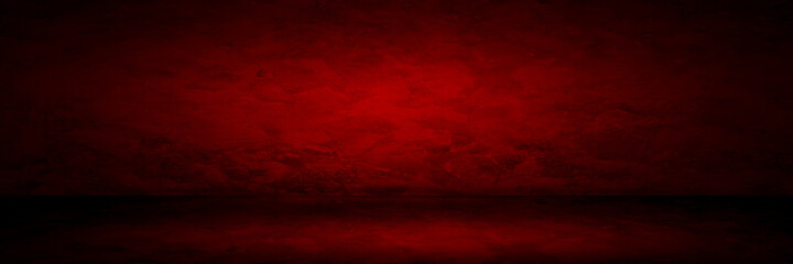 Red background abstract gradient spotlight room texture background. Studio backdrop wallpaper light room cement wall color red and empty space.