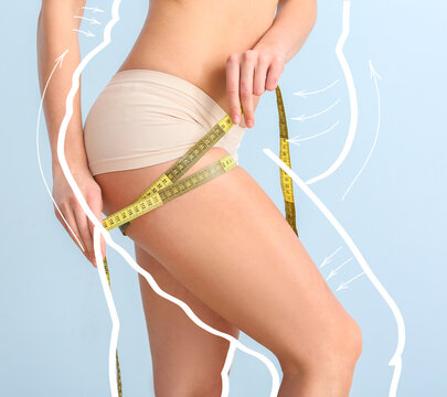 Young woman with measuring tape after weight loss on color background