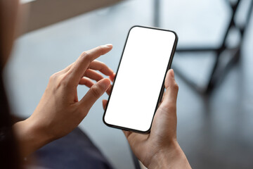 Fototapeta Close-up of a businessman hand holding a smartphone white screen is blank the background is blurred.Mockup. obraz
