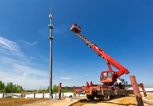An aerial work platform, also known as an aerial device, elevating work platform, cherry picker, bucket truck, mobile elevating work platform maintenances the telecommunication tower.