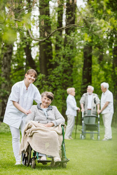 Elder and disabled people in the garden spending time together