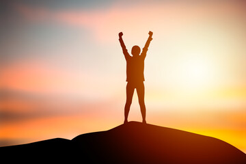 Obraz Silhouette women standing raise both hand with sunset blurry background. Concept of freedom, Success of life. Business and organization goal. Travel and adventure concept - fototapety do salonu