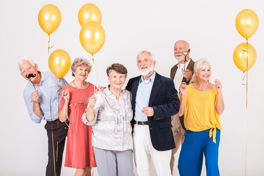 Group of happy senior people celebrating and having fun together
