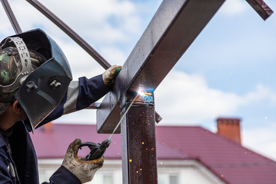 A worker welds metal to the canopy. Technologies