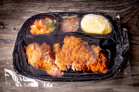 Fried Chicken TV dinner frozen and covered in cellophane