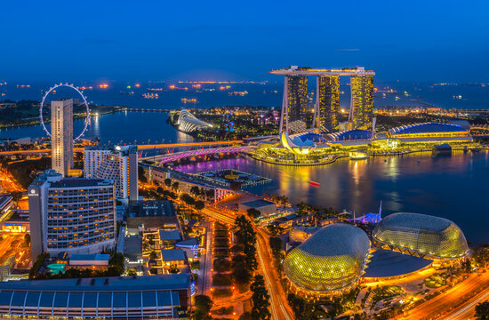 The bird's-eye view at Singapore cityscape around Marina bay and Modern high building in business district area at twilightis one of Singapore's most beautiful highlights.