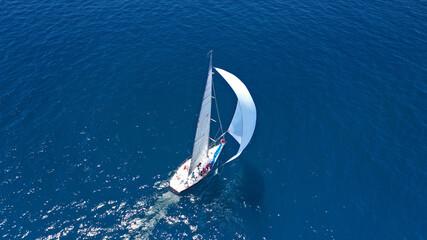 Aerial drone top down photo of beautiful sailing boat cruising in deep blue Atlantic open ocean sea