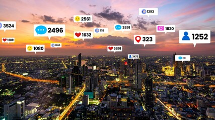 Social media icons fly over city downtown showing people engagement connection through social network application platform . Concept for online community and social media marketing strategy .