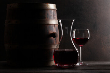 Obraz Decanter, red wine and old wooden barrel - fototapety do salonu