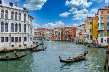 Grand Canal with gondola in Venice, Italy. Architecture and landmarks of Venice. Venice postcard