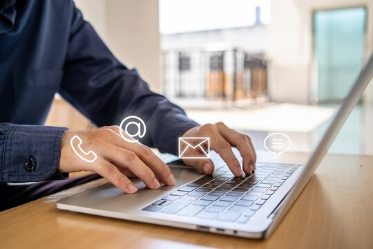 Hotline service, Customer support hotline Contact us people connection. Businessman using laptop with the email, call phone, address, Chat message icons