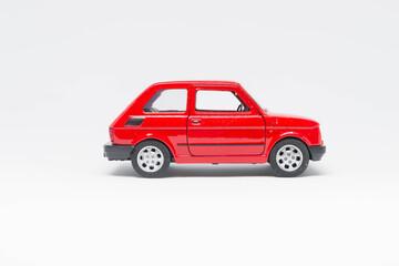 Obraz Czerwony maluch zabawka na białym tle - fototapety do salonu