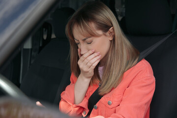 Fototapeta Young woman suffering from nausea in car obraz