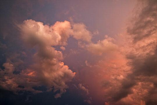 Majestic clouds illuminated by sunset light