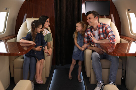Happy family together in airplane during flight
