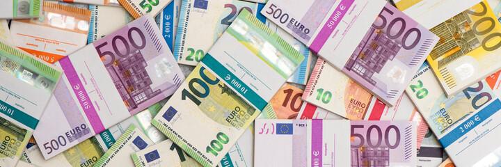 Fototapeta bundles of many Euro currency banknotes obraz