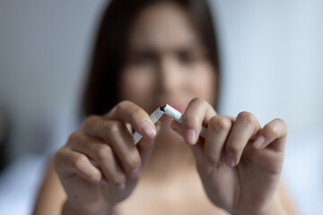woman trying to stop smoking, concept of world no tobacco day, quit smoking, female smoker,...