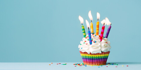 Fototapeta Birthday cupcake with lots of colorful candles obraz