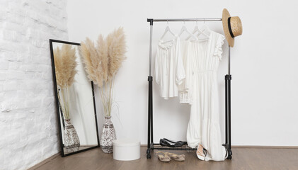 Fototapeta Women's fashion. Summer white clothes made from natural viscose and cotton fabrics in fashion atelier. obraz