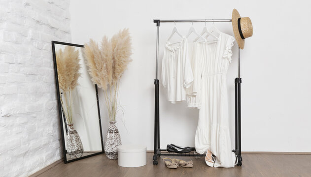Women's fashion. Summer white clothes made from natural viscose and cotton fabrics in fashion atelier.