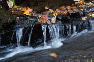 Cascades with rocks outdoors Wall mural