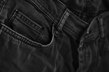 Pocket details of black jeans. Sewing details of black jeans.