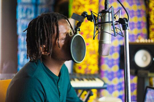 Man in home recording studio