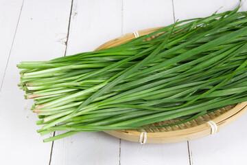 Fototapeta Fresh Chinese chives,Garlic chives on wooden background obraz