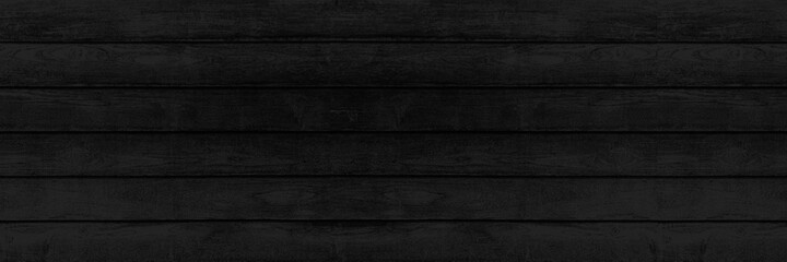 Obraz Panorama of New black vintage wooden wall texture and background seamless or a black wooden fence - fototapety do salonu