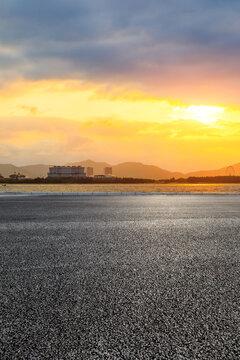 Asphalt road and beautiful seaside scenery at sunset.