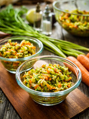 Fresh spring vegetable salad on wooden table