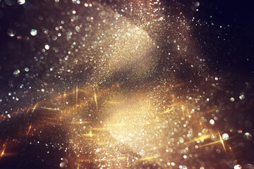 Obraz background of abstract gold and black glitter lights. defocused - fototapety do salonu