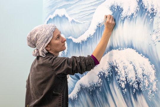Mature Woman Artist Draws A Mural On A Marine Theme, Close Up