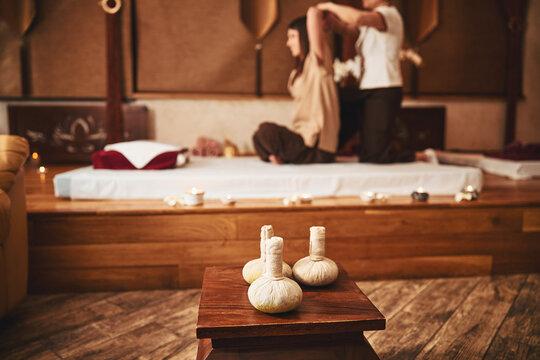 Three thai herbal compress balls lying on stool