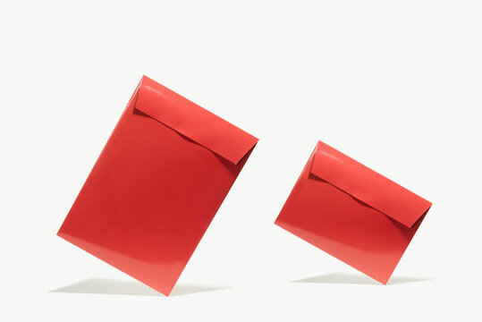 Set with two closed red envelope on white isolated background.