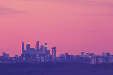 Pink sunset on the background of the evening city, copy space